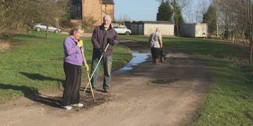 tidying the road to Railway Cottages